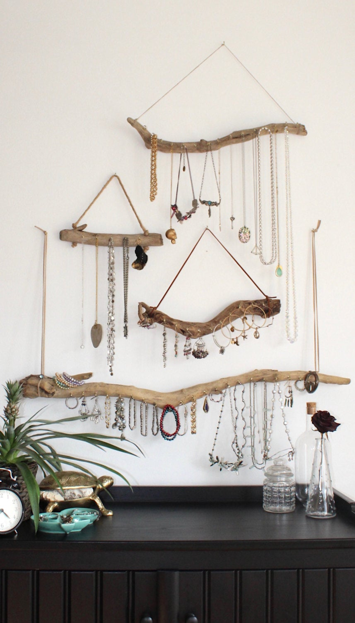 """<h2>Put Your Jewelry On Display</h2><br>This made-to-order set allows you to mount your jewelry on the wall, avoiding the inevitable frustration of tangled necklaces and bracelets that can occur in a drawer or a box. Extra points for the fact that it adds a bit of art & sparkle to your space!<br><br><strong>Curiographer</strong> Driftwood Jewelry Organizer, $, available at <a href=""""https://go.skimresources.com/?id=30283X879131&url=https%3A%2F%2Fwww.etsy.com%2Flisting%2F222020989%2Fdriftwood-jewelry-organizer-made-to%3F"""" rel=""""nofollow noopener"""" target=""""_blank"""" data-ylk=""""slk:Etsy"""" class=""""link rapid-noclick-resp"""">Etsy</a>"""