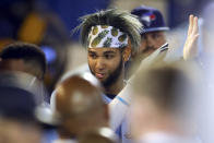 Toronto Blue Jays' Lourdes Gurriel Jr. celebrates in the dugout after scoring against the Boston Red Sox during the fourth inning of a baseball game Tuesday, May 18, 2021, in Dunedin, Fla. (AP Photo/Mike Carlson)
