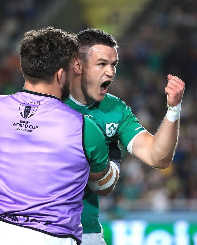 Johnny Sexton, right, celebrates with Andrew Porter, left, after scoring a try in Ireland's bonus-point win over Samoa (Adam Davy/PA)