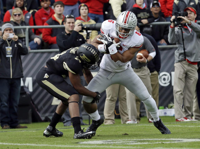 Ohio State wide receiver Evan Spencer, right, is tackled by Purdue defensive back Frankie Williams after making a catch during the first half of an NCAA college football game in West Lafayette, Ind., Saturday, Nov. 2, 2013. (AP Photo/Michael Conroy)