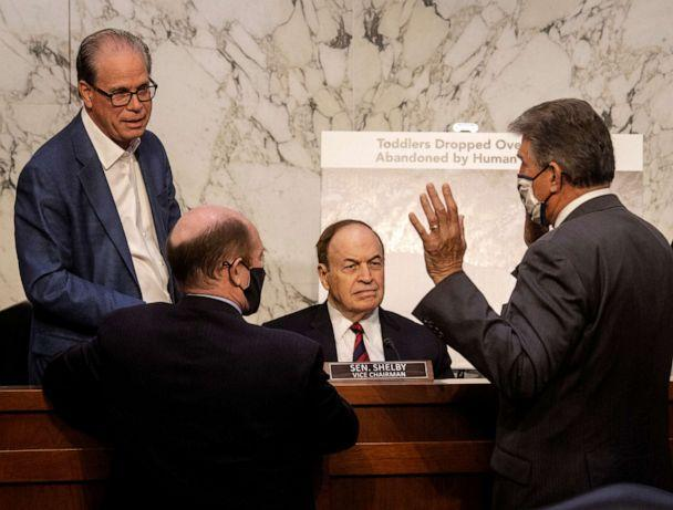PHOTO: Republican senators Mike Braun, Chris Coons, Richard Selby and Joe Manchin talk during a break in the Senate Appropriations committee hearing to examine domestic violent extremism, on May 12, 2021, in Washington, D.C. (Bill O'Leary/Pool via Getty Images)