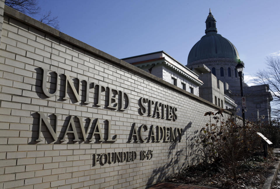 """FILE - This Jan. 9, 2014 file photo shows a sign outside of an entrance to the U.S. Naval Academy campus in Annapolis, Md. A U.S. Naval Academy midshipman has asked a federal judge in Maryland to block his expulsion over messages he posted on social media, including one in which he said Breonna Taylor received """"justice"""" when police killed the Black woman during a drug raid on her Kentucky home. U.S. District Judge Ellen Hollander didn't immediately rule Friday, Oct. 30, 2020 after presiding over a hearing on Chase Standage's request for an order allowing him to graduate. (AP Photo/Patrick Semansky, File)"""