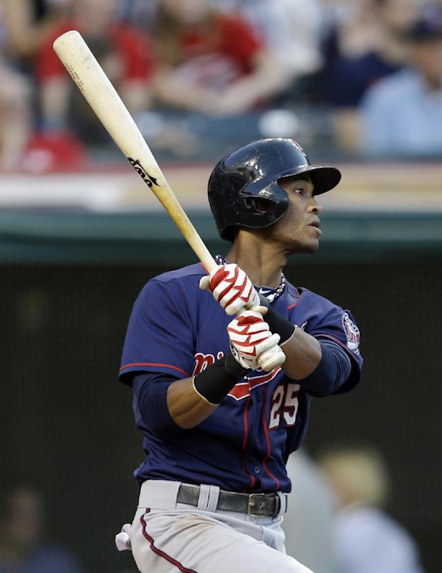 Minnesota Twins' Pedro Florimon watches his RBI double off Cleveland Indians starting pitcher Ubaldo Jimenez in the second inning of a baseball game, Friday, Aug. 23, 2013, in Cleveland. (AP Photo/Tony Dejak)