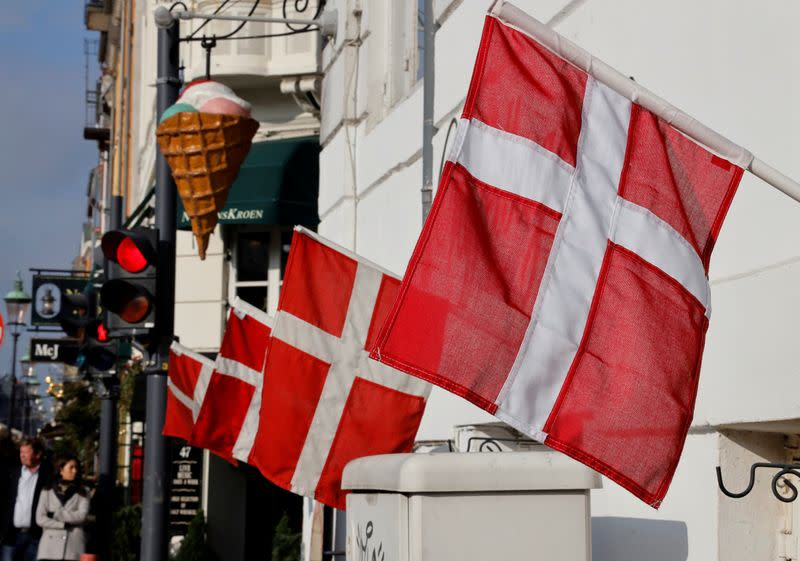 Denmark drops plan to lift curbs on public gatherings as infections spike