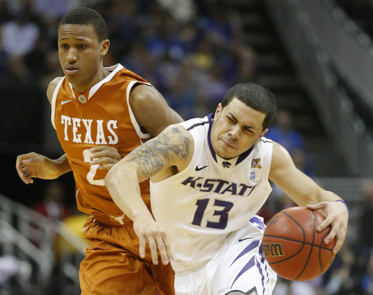 Kansas State guard Angel Rodriguez (13) is fouled by Texas guard Demarcus Holland (2) during the second half of an NCAA college basketball game in the Big 12 tournament on Thursday, March 14, 2013, in Kansas City, Mo. Kansas State defeated Texas 66-49. (AP Photo/Orlin Wagner)