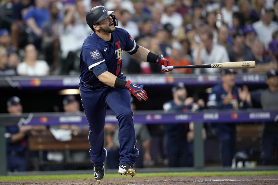 American League's Mike Zunino, of the Tampa Bay Rays, watches his solo home run leave the park during the sixth inning of the MLB All-Star baseball game, Tuesday, July 13, 2021, in Denver. (AP Photo/David Zalubowski)
