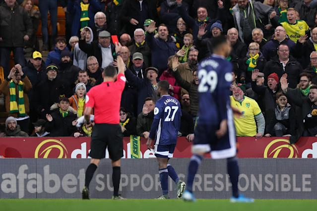 Kabasele is shown a red card. (Photo by Naomi Baker/Getty Images)