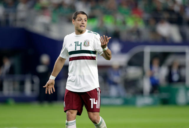 In this image taken on Tuesday, March 27, 2018 Mexico forward Javier Hernandez jogs across the field talking to an official, not pictured, during a international friendly soccer match against Croatia in Arlington, Texas, Tuesday, March 27, 2018. (AP Photo/Tony Gutierrez)