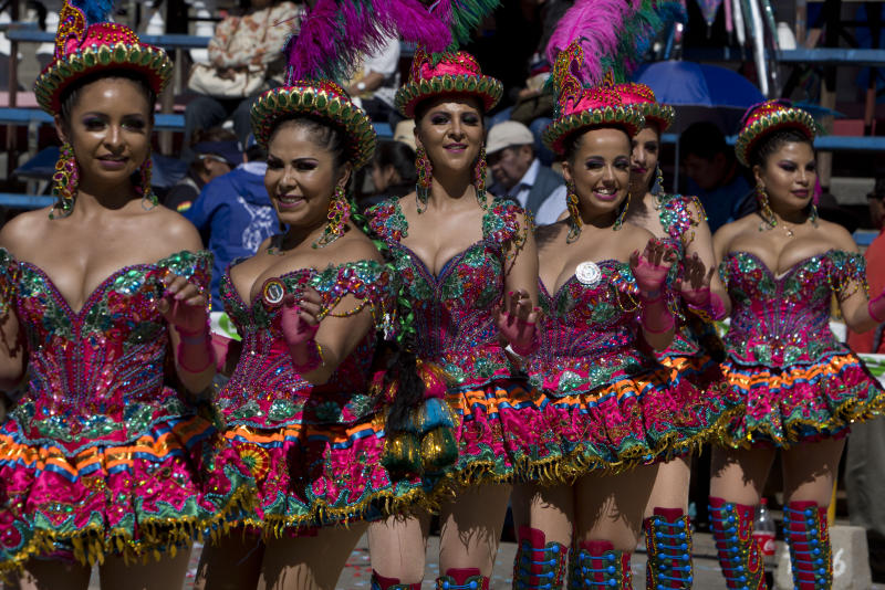 "Women perform in the traditional ""Morenada"" dance during Carnival, in Oruro, Bolivia, Saturday, March 2, 2019. The unique festival features spectacular folk dances, extravagant costumes, beautiful crafts, lively music, and up to 20 hours of continuous partying with lots of tourists, drawing crowds of up people annually. (AP Photo/Juan Karita)"