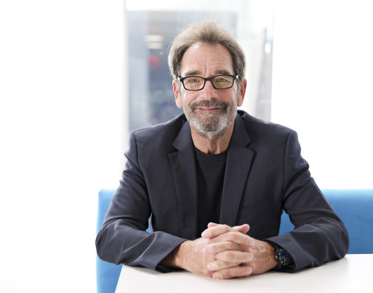 """FILE - This Oct. 2, 2019 file photo shows musician Huey Lewis posing for a portrait in New York. The 69-year-old frontman for Huey Lewis & The News has a new album """"Weather"""" out on Feb. 14. (Photo by Brian Ach/Invision/AP, File)"""