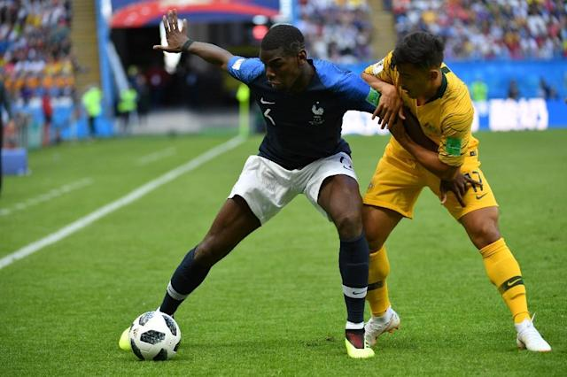 Daniel Arzani came up against France's Paul Pogba in the Australian's World Cup debut (AFP Photo/SAEED KHAN)