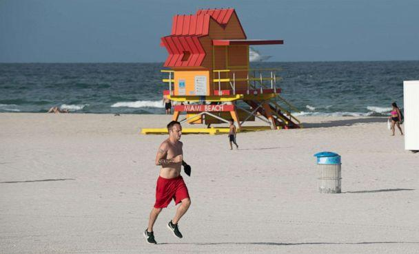 PHOTO: A man runs past a lifeguard stand in Miami Beach, Fla., July 20, 2020. (Michele Eve Sandberg/REX/Shutterstock)