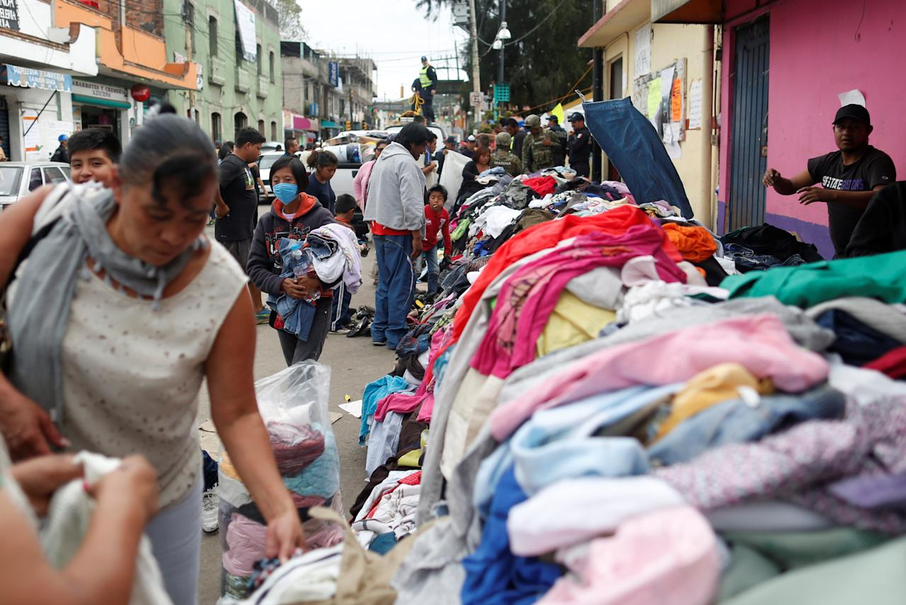 Residents look for donated clothes at a collection center after the earthquake in Xochimilco, on the outskirts of Mexico City, Mexico September 25, 2017. REUTERS/Carlos Jasso