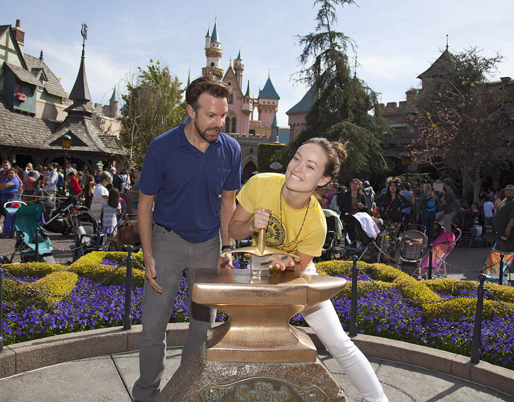 "ANAHEIM, CA - MARCH 26: In this handout photo provided by Disney Parks, Newly-engaged couple Jason Sudeikis and Olivia Wilde try their luck at removing the ""Sword in the Stone"" at Disneyland park in Anaheim on March 26, 2013 in Anaheim, California. (Photo by Paul Hiffmeyer/Disney Parks via Getty Images)"