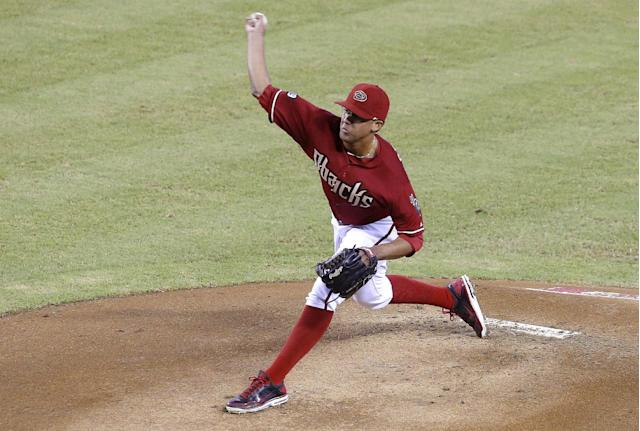 Arizona Diamondbacks' Randall Delgado throws against the Toronto Blue Jays in the first inning of a baseball game on Wednesday, Sept. 4, 2013, in Phoenix. (AP Photo/Ross D. Franklin)