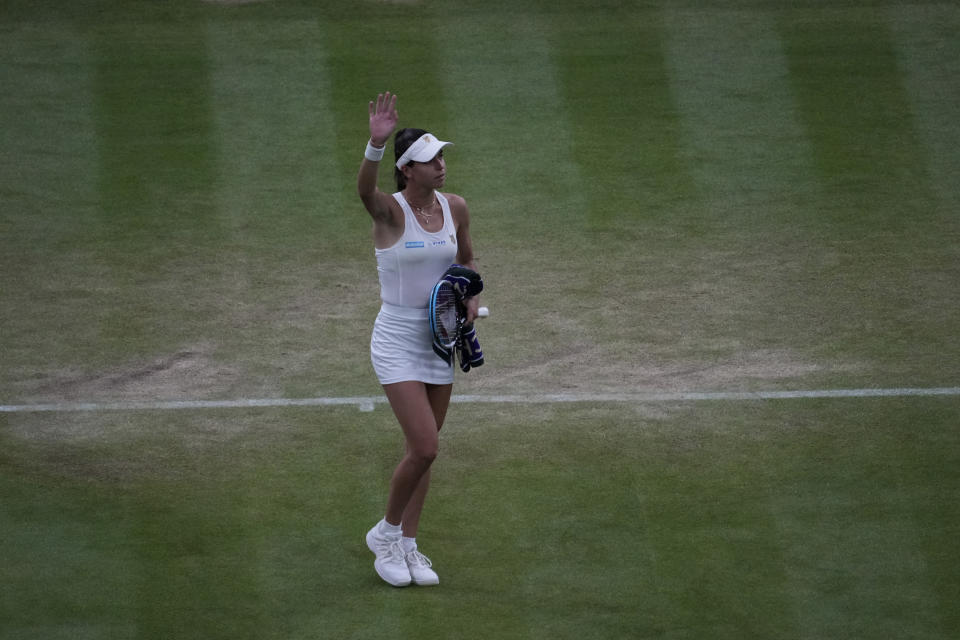 Australia's Ajla Tomljanovic acknowledges the audience as she leaves the court after Britain's Emma Raducanu retired during the women's singles fourth round match on day seven of the Wimbledon Tennis Championships in London, Monday, July 5, 2021. (AP Photo/Alberto Pezzali)