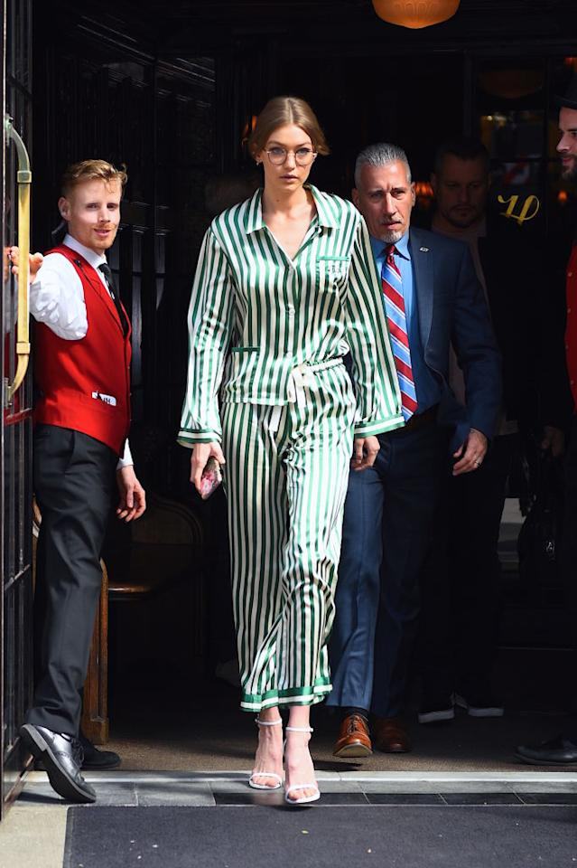 <p>The 21-year-old sashayed through NYC in personally monogrammed green striped silk pajamas by Morgan Lane. <i>(Photo: Getty)</i> </p>