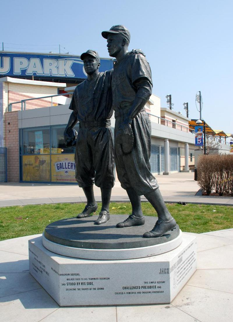 "This undated image provided by the Brooklyn Cyclones shows a statue of Pee Wee Reese and Jackie Robinson at MCU Park in the Coney Island section of the Brooklyn borough of New York, where the minor league Cyclones team plays. A new film, ""42,"" tells the inspiring story of how Robinson integrated Major League Baseball when he played for the Brooklyn Dodgers. The pedestal of the statue states that Reese, captain of the Dodgers, ""stood by Jackie Robinson against prejudiced fans and fellow players"" by walking over to Robinson, standing next to him and ""silencing the taunts of the crowd""  during a game in Cincinnati. (AP Photo/Brooklyn Cyclones)"