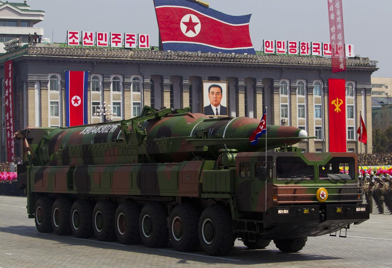A North Korean vehicle carrying a missile passes by during a mass military parade in Pyongyang's Kim Il Sung Square to celebrate 100 years since the birth of the late North Korean founder Kim Il Sung on Sunday, April 15, 2012. North Korean leader Kim Jong Un delivered his first public televised speech Sunday, just two days after a failed rocket launch, portraying himself as a strong military chief unafraid of foreign powers during festivities meant to glorify his grandfather, North Korea founder Kim Il Sung. (AP Photo/David Guttenfelder)