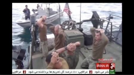 U.S. sailors are pictured on a boat with their hands on their heads at an unknown location in this still image taken from video taken January 12-13, 2016. REUTERS/IRINN via Reuters TV
