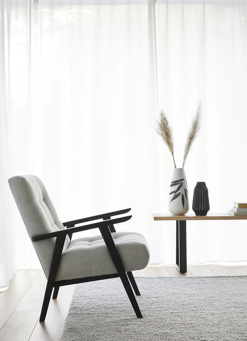"""<p>Other items to look forward to in the range include simple pieces, quality craftsmanship and gorgeous furnishings that wouldn't look out of place in an <a href=""""https://www.housebeautiful.com/uk/decorate/walls/a35162682/interior-colour-trends-2021/"""" rel=""""nofollow noopener"""" target=""""_blank"""" data-ylk=""""slk:interiors"""" class=""""link rapid-noclick-resp"""">interiors</a> magazine. </p><p>Our favourite is this gorgeous chair (£299), which is the perfect addition to a stylish and minimalist environment. Be sure to keep an eye open for it when it launches next month...<br></p>"""