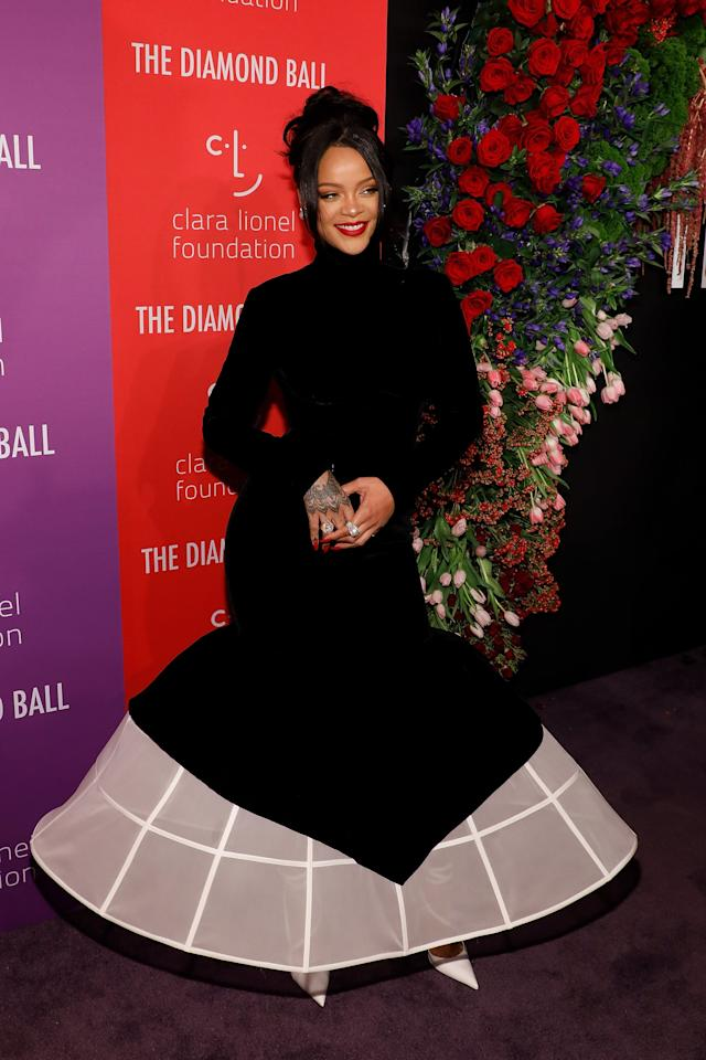 "<p>For her annual Diamond Ball, <a class=""sugar-inline-link ga-track"" title=""Latest photos and news for Rihanna"" href=""https://www.popsugar.com/Rihanna"" target=""_blank"" data-ga-category=""Related"" data-ga-label=""https://www.popsugar.com/Rihanna"" data-ga-action=""&lt;-related-&gt; Links"">Rihanna</a> wore a voluminous <a href=""https://www.popsugar.com/fashion/rihanna-dress-diamond-ball-2019-46616728"" class=""ga-track"" data-ga-category=""Related"" data-ga-label=""https://www.popsugar.com/fashion/rihanna-dress-diamond-ball-2019-46616728"" data-ga-action=""In-Line Links"">Givenchy gown</a>.</p>"