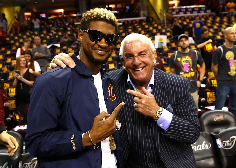 Recording artist Usher (L) and former wrestler Ric Flair attend Game 3 of the 2017 NBA Finals between the Golden State Warriors and the Cleveland Cavaliers at Quicken Loans Arena on June 7, 2017 in Cleveland, Ohio. NOTE TO USER: User expressly acknowledges and agrees that, by downloading and or using this photograph, User is consenting to the terms and conditions of the Getty Images License Agreement. (Photo by Ronald Martinez/Getty Images)