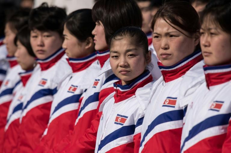 North Korea's figure skater Ryom Tae Ok (C) stands with her teammates during a welcoming ceremony at the athletes village of the 2018 Pyeongchang Winter Olympic games, in Gangneung, on February 8, 2018