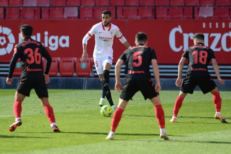 Sevilla hat-trick hero Youssef en-Nesyri (2L) draws attention from a pack of Real Sociedad defenders in La Liga at the weekend