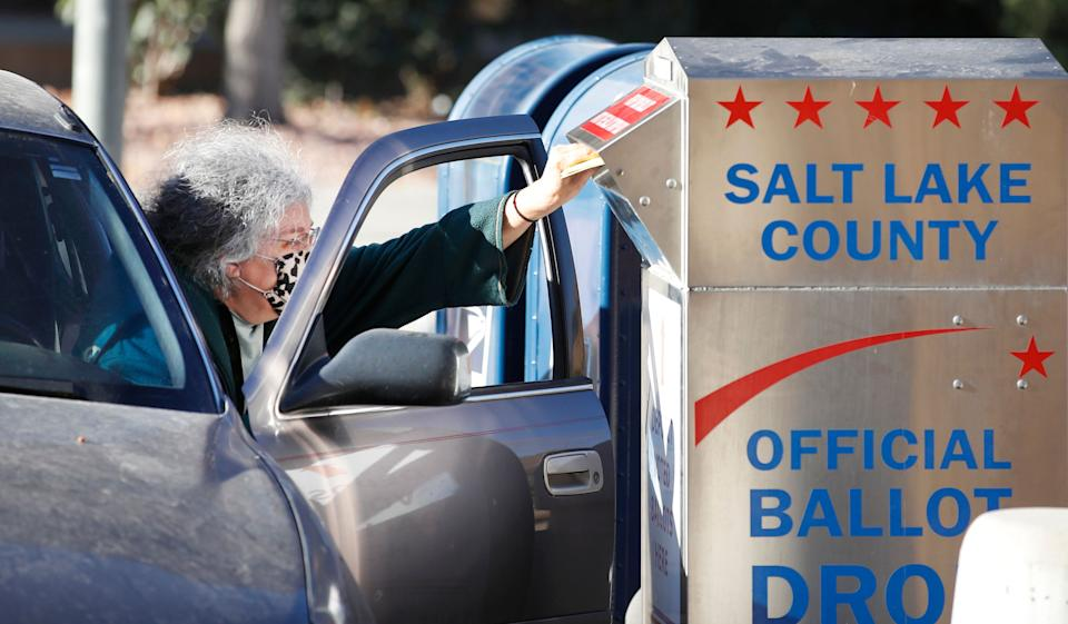 A voter drops off her mail in ballot at a dropbox at the Salt Lake County election office in Salt Lake City, Utah, on Oct. 29, 2020. (Photo: GEORGE FREY/AFP via Getty Images)