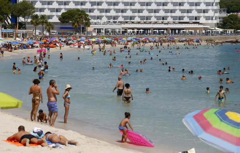 People enjoy Magaluf beach in Mallorca