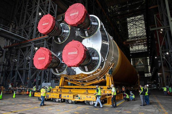 The business end of the first Space Launch System core stage being moved inside the Vehicle Assembly Building at the Kennedy Space Center. NASA plans to launch the huge new rocket on an unpiloted maiden flight around the moon late this year. / Credit: NASA