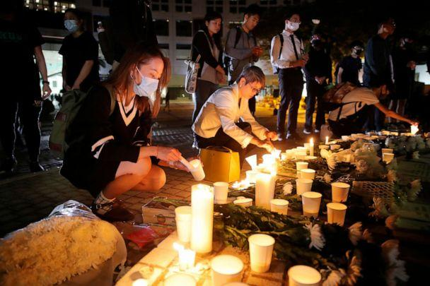 PHOTO: Protesters light candles to pay tribute to Chow Tsz-Lok in Hong Kong, Nov. 8, 2019. (Kin Cheung/AP)