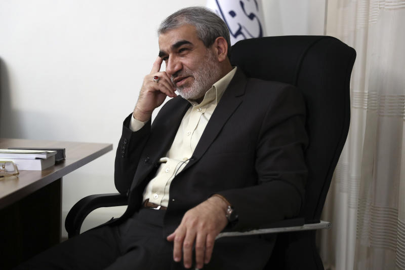 In this Nov. 9, 2019, photo, Abbas Ali Kadkhodaei, a prominent member of Iran's powerful Guardian Council, listens to a question during an interview with The Associated Press, in Tehran, Iran. A prominent member of Iran's powerful Guardian Council has told The Associated Press that the Islamic Republic should stop honoring the terms of its collapsing 2015 nuclear deal with world powers amid tensions with the U.S. (AP Photo/Vahid Salemi)