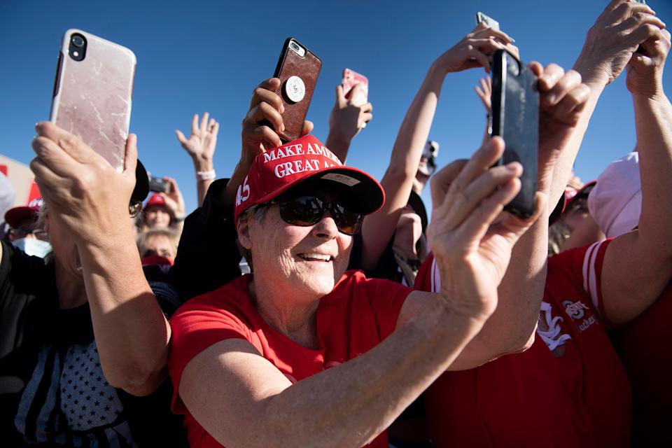 People cheer as US President Donald Trump arrives during a Make America Great Again rally at Phoenix Goodyear Airport October 28, 2020, in Goodyear, Arizona. (Photo by Brendan Smialowski / AFP) (Photo by BRENDAN SMIALOWSKI/AFP via Getty Images)