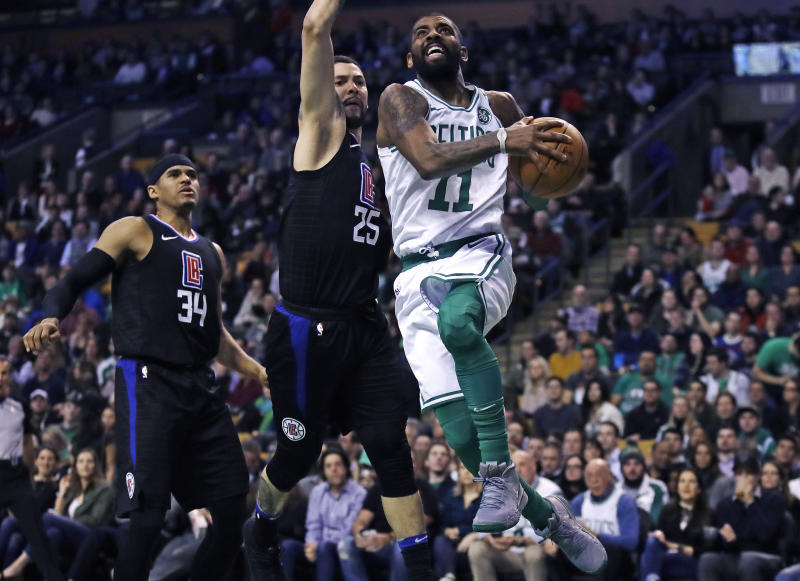 f3d69ac7b89 Boston Celtics guard Kyrie Irving (11) drives past Los Angeles Clippers  guard Austin Rivers (25) and forward Tobias Harris (34) during the first  quarter of ...