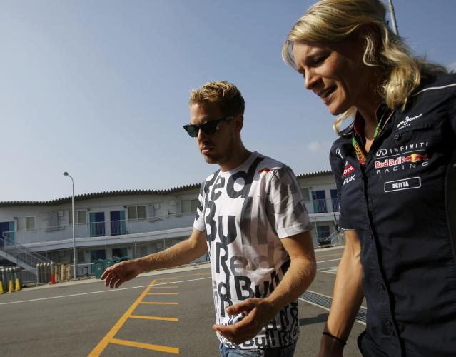 Red Bull Formula One driver Sebastian Vettel of Germany walks on the paddock before the third practice session of the Japanese F1 Grand Prix at the Suzuka circuit October 12, 2013. REUTERS/Toru Hanai (JAPAN - Tags: SPORT MOTORSPORT F1)