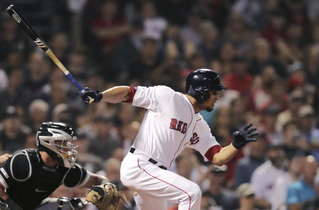 Boston Red Sox's Marco Hernandez follows through on his baseball game-winning bases-loaded single in the bottom of the ninth inning against the Chicago White Sox at Fenway Park in Boston, Monday, June 24, 2019. (AP Photo/Charles Krupa)