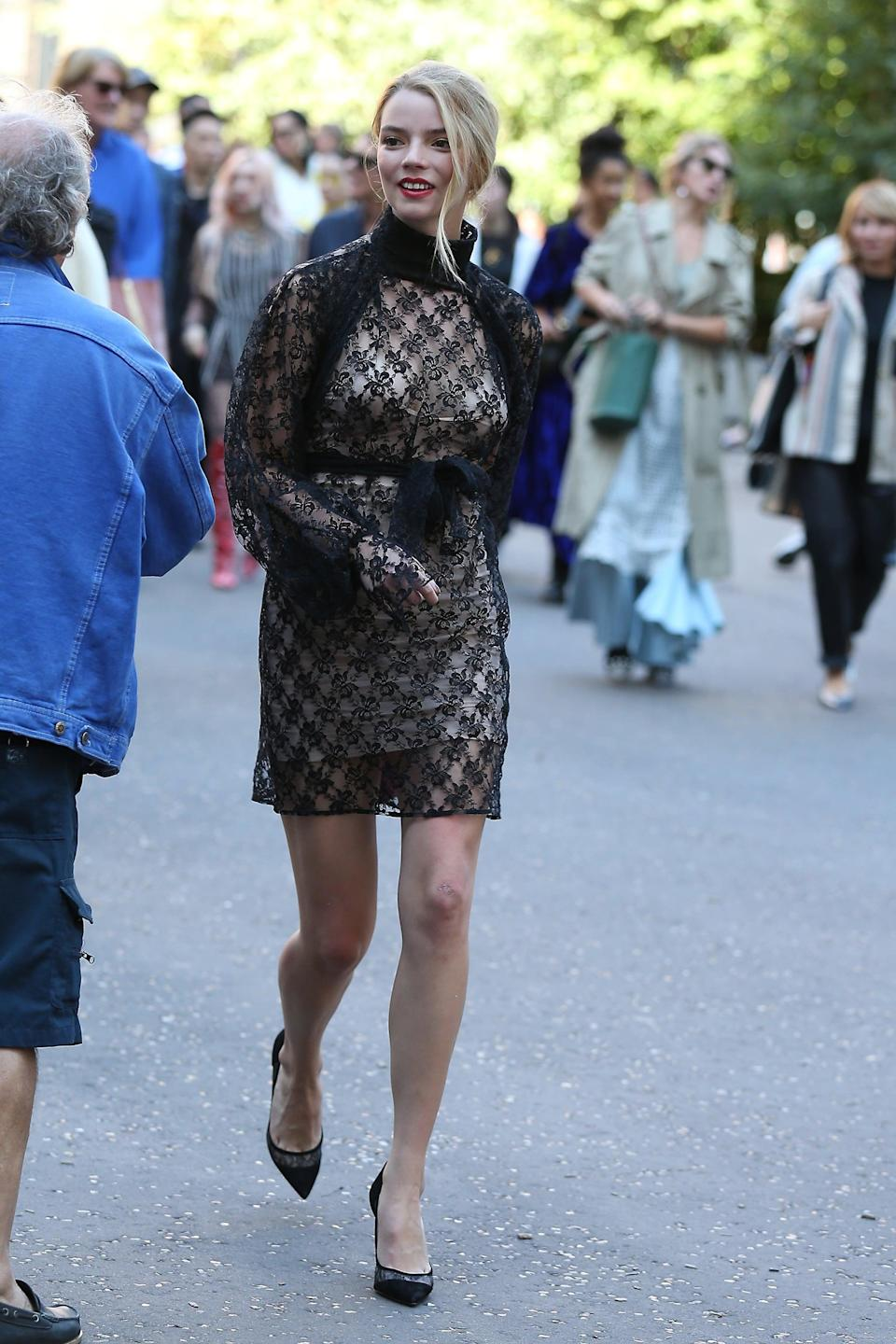 <p>Anya was on the scene at London Fashion Week in 2018, sporting this Christopher Kane minidress with sheer-paneled pumps.</p>