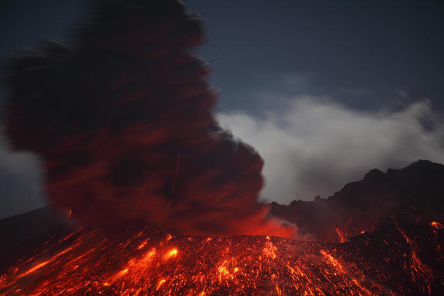 PIC FROM MARTIN RIETZE / GUZELIAN - (PICTURED - Sakurajima Volcano in Japan) A thrill-seeking volcano chaser witnessed the rare moment a lightning storm collided with an erupting stream of lava. These lightstorm images were caught up close by photographer Martin Rietze who hunts out this exploding phemomena in active volcanos right across the world. This light spectacle was pictured 3-4km east of the Sakurajima Volcano in the Kaghoshima area of South Japan. - SEE CATERS COPY **NOT FOR SALE IN GERMANY / AUSTRIA**