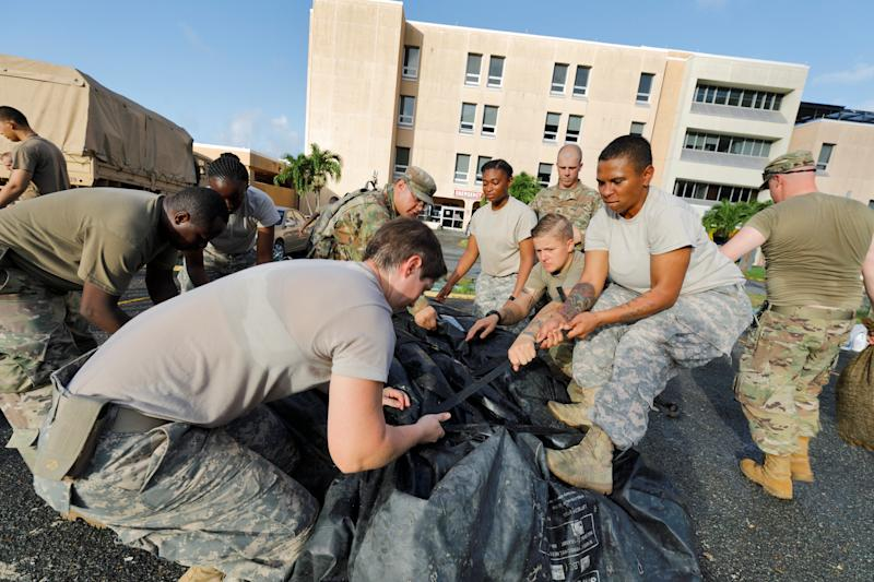 On the U.S. Virgin Islands on Sunday, soldiers from the 602nd Area Support Medical Company break down a field hospital outside the Schneider Regional Medical Center while preparing to evacuate in advance of Maria. (Jonathan Drake / Reuters)