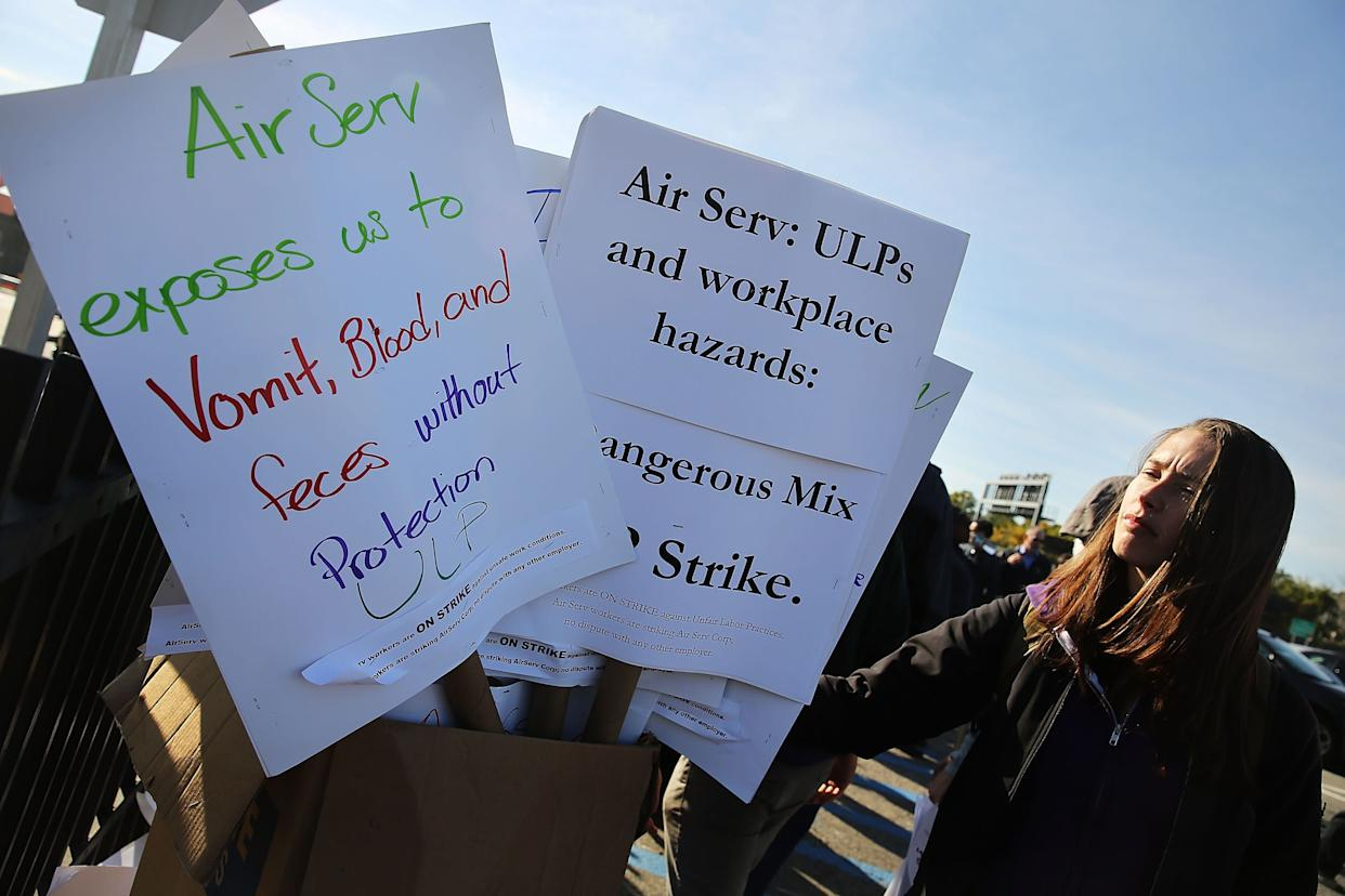 On October 9, 2014, nearly 200 airline cabin cleaners walk on a picket line at LaGuardia International Airport after going on strike overnight out of concern over health and safety issues including the possible exposure to the Ebola virus.