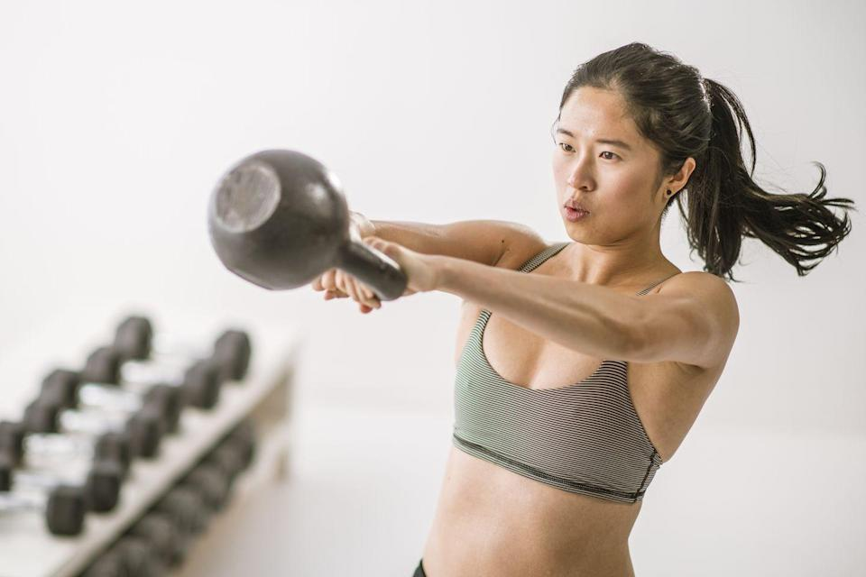<p>Kettlebell swings work virtually every single muscle in the body, but they heavily engage the hamstrings and glutes. A full kettlebell swing goes all the way above your head, whereas a Russian kettlebell swing ends at eye level and allows you to focus on strength in the hips.<strong><em><br></em></strong></p><p><strong>How to: </strong>Stand with your feet hip width apart and a slight bend in your knees. Engage your core and be sure to keep a flat back throughout the movement. Hold the kettlebell with both hands in an overhand grip and start with the kettlebell hanging in between your thighs with arms straight and engaged. Lean forward, then use your hips to swing the kettlebell up to eye level. Lower back down and repeat. </p>