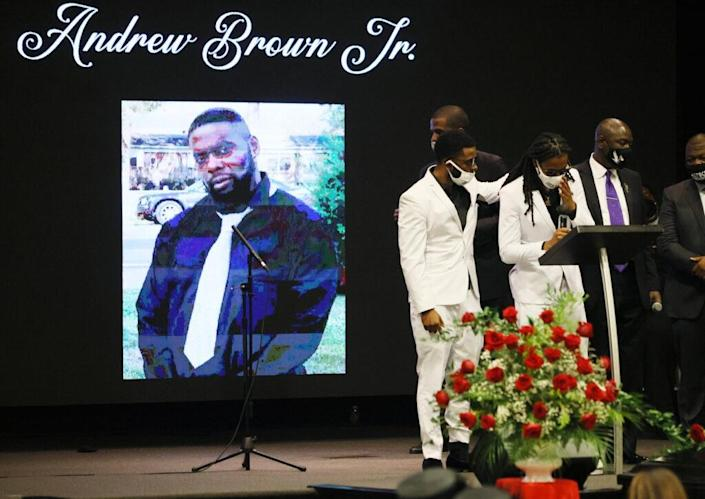 ELIZABETH CITY, NORTH CAROLINA – MAY 03: Jha'rod Ferebee (L) and Khalil Ferebee speak during the funeral for their father Andrew Brown Jr. at the Fountain of Life church on May 03, 2021 in Elizabeth City, North Carolina. Mr. Brown was shot to death by Pasquotank County Sheriff's deputies on April 21. (Photo by Joe Raedle/Getty Images)