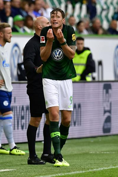 Wolfsburg's Dutch forward Wout Weghorst was initially shown a red card in Saturday's 2-1 win over Schalke, which was later downgraded to a yellow card after the VAR intervened