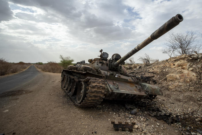 A destroyed tank is seen by the side of the road south of Humera, in an area of western Tigray annexed by the Amhara region during the ongoing conflict, in Ethiopia Saturday, May 1, 2021. Ethiopia faces a growing crisis of ethnic nationalism that some fear could tear Africa's second most populous country apart, six months after the government launched a military operation in the Tigray region to capture its fugitive leaders. (AP Photo/Ben Curtis)