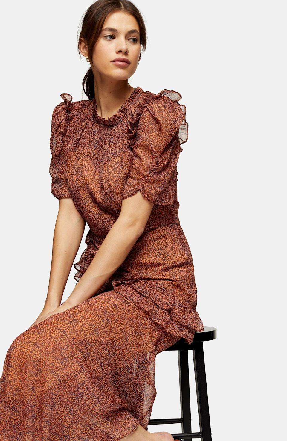 <p>Wear this <span>Topshop Floral Ruffle Midi Dress</span> ($40, originally $95) on your next fancy dinner date.</p>