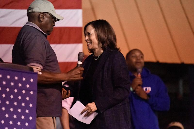 Kamala Harris takes the stage at a candidate cookoff after being introduced by House Majority Whip Jim Clyburn in October 2019 in Orangeburg, S.C. Joe Biden leaned on Clyburn for advice.