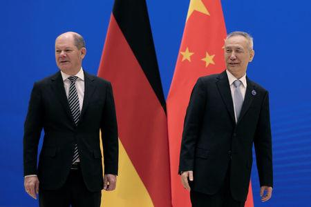 German Finance Minister Olaf Scholz, left, and Chinese Vice Premier Liu He arrive for the China-Germany High Level Financial Dialogue at the Diaoyutai State Guesthouse in Beijing