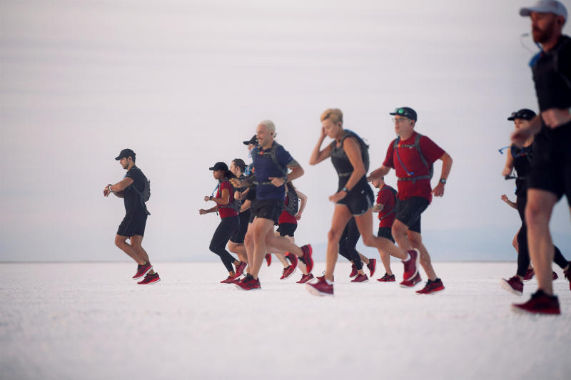 Runners, including professional athletes, set off at sunrise in the Eternal Run at the Bonneville Salt Flats, Utah, USA. (Credit: ASICS).